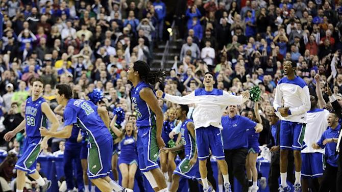 Florida Gulf Coast players celebrate after winning a third-round game against San Diego State in the NCAA college basketball tournament, Sunday, March 24, 2013, in Philadelphia. Florida Gulf Coast won 81-71. (AP Photo/Matt Slocum)