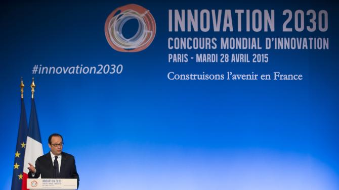 French President Francois Hollande delivers a speech after awarding trophies to the laureates of the 'global Innovation 2030 contest' during a reception at the Elysee Palace in Paris