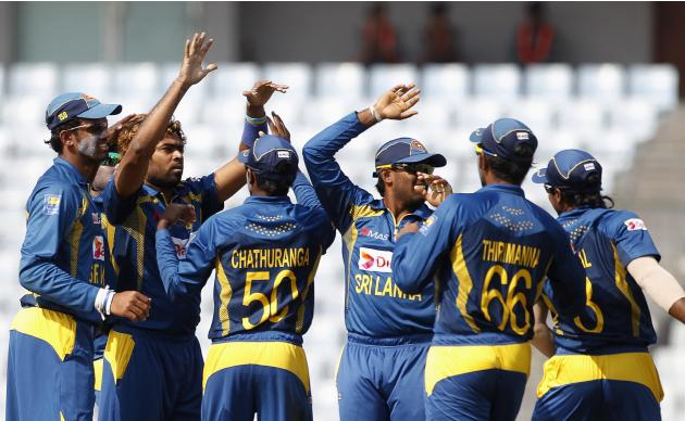Sri Lanka's fielders celebrate with teammate Lasith Malinga as he dismissed Pakistan's Mohammad Hafeez successfully during their 2014 Asia Cup final match in Dhaka