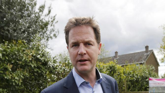 Britain's Deputy Prime Minister and Liberal Democrat Party leader Nick Clegg answers a reporter's questions during a visit to a day nursery in Poole