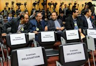Iranian journalists wait for the final press conference on the third day of talks on Iran's nuclear programme, on late November 9, 2013 in Geneva