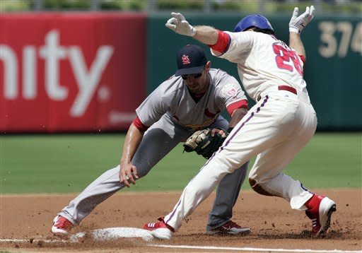Pierre helps Phillies top Cardinals in 11