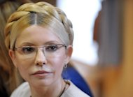 Ukraine on Monday postponed the latest trial of jailed ex-premier Yulia Tymoshenko (seen here in October 2011) until after the Euro 2012 final as pressure mounted on the tournament co-hosts to drop the controversial case