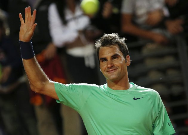 Roger Federer of Switzerland celebrates after winning his men's singles semi-final match  against Benoit Paire of France at the Rome Masters tennis tournament