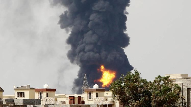 Flames and smoke billow from an oil depot where a huge blaze started following clashes around Tripoli airport on July 28, 2014