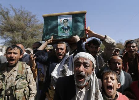 Followers of the Houthi movement recite prayers as they carry the coffin of a fellow fighter during his funeral in Sanaa