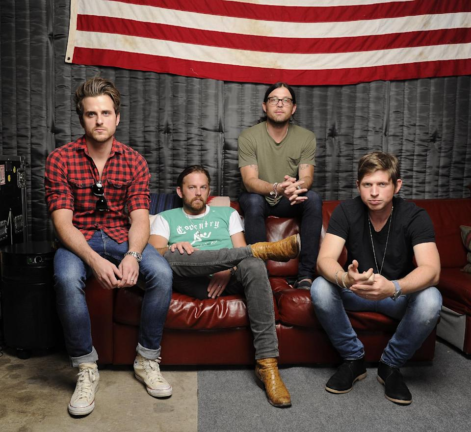 "This Sept. 5, 2013 photo shows members of King of Leon, from left, Jared Followill, Caleb Followill, Nathan Followill and Matthew Followill in Nashville, Tenn. The band's latest album, ""Mechanical Bull,"" will be released on Tuesday, Sept. 24. (Photo by Donn Jones/Invision/AP)"