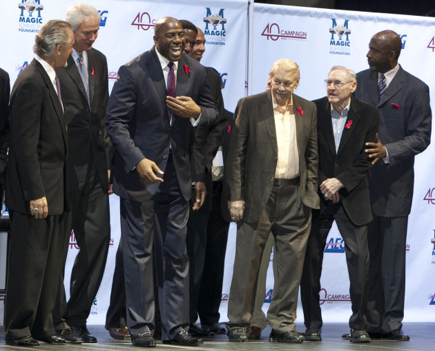 ORRECTS THAT BUSS WAS 80-YEARS-OLD, AND NOT 79 AS ORIGINALLY SENT -  FILE - In this Nov. 7, 2011 file photo, Los Angeles Lakers owner Jerry Buss, third from right, looks towards Magic Johnson, third f