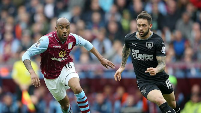 Aston Villa's Fabian Delph, left, and Burnley's Danny Ings battle for the ball during the English Premier League soccer match at Villa Park, Birmingham, England, Sunday May 24, 2015. (Scott Heavey/PA via AP) UNITED KINGDOM OUT  NO SALES  NO ARCHIVE