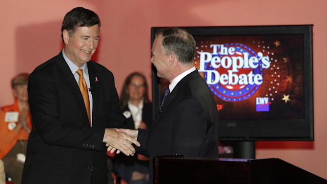 FILE - In this Oct. 8, 2012 file photo, Virginia Republican Senate candidate, former Sen. George Allen, left, shakes with Democrat, former Gov. Timothy M. Kaine, after their debate in Richmond, Va. The party that runs the Senate next year may be decided by how well President Barack Obama and Mitt Romney do in toss-up states like Virginia, where ballots features parallel Senate races about as races about as tight as the presidential contest. (AP Photo/Steve Helber, File)