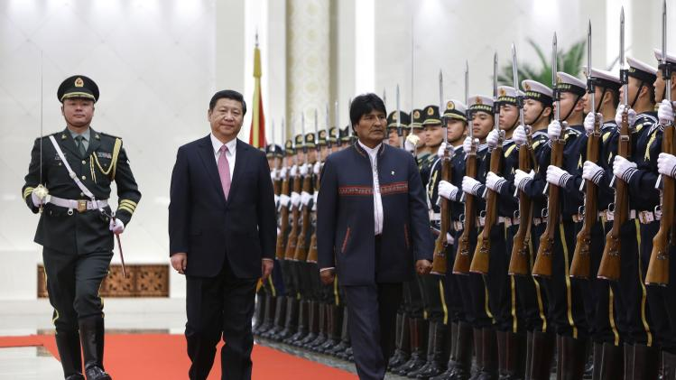 Bolivia's President Morales and China's President Xi inspect honour guards during a welcoming ceremony at the Great Hall of the People in Beijing