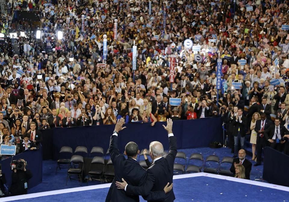 President Barack Obama, left, and Vice President Joe Biden wave to delegates at the Democratic National Convention in Charlotte, N.C., on Thursday, Sept. 6, 2012. (AP Photo/Charlie Neibergall)