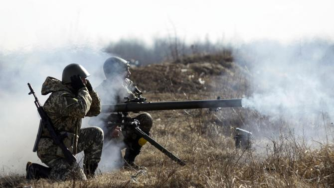 Newly mobilized Ukrainian paratroopers fire anti-tank grenade launcher during military drill near Zhytomyr
