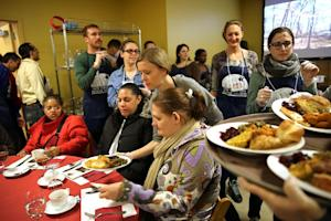 Volunteers at the New York City Rescue Mission serve…