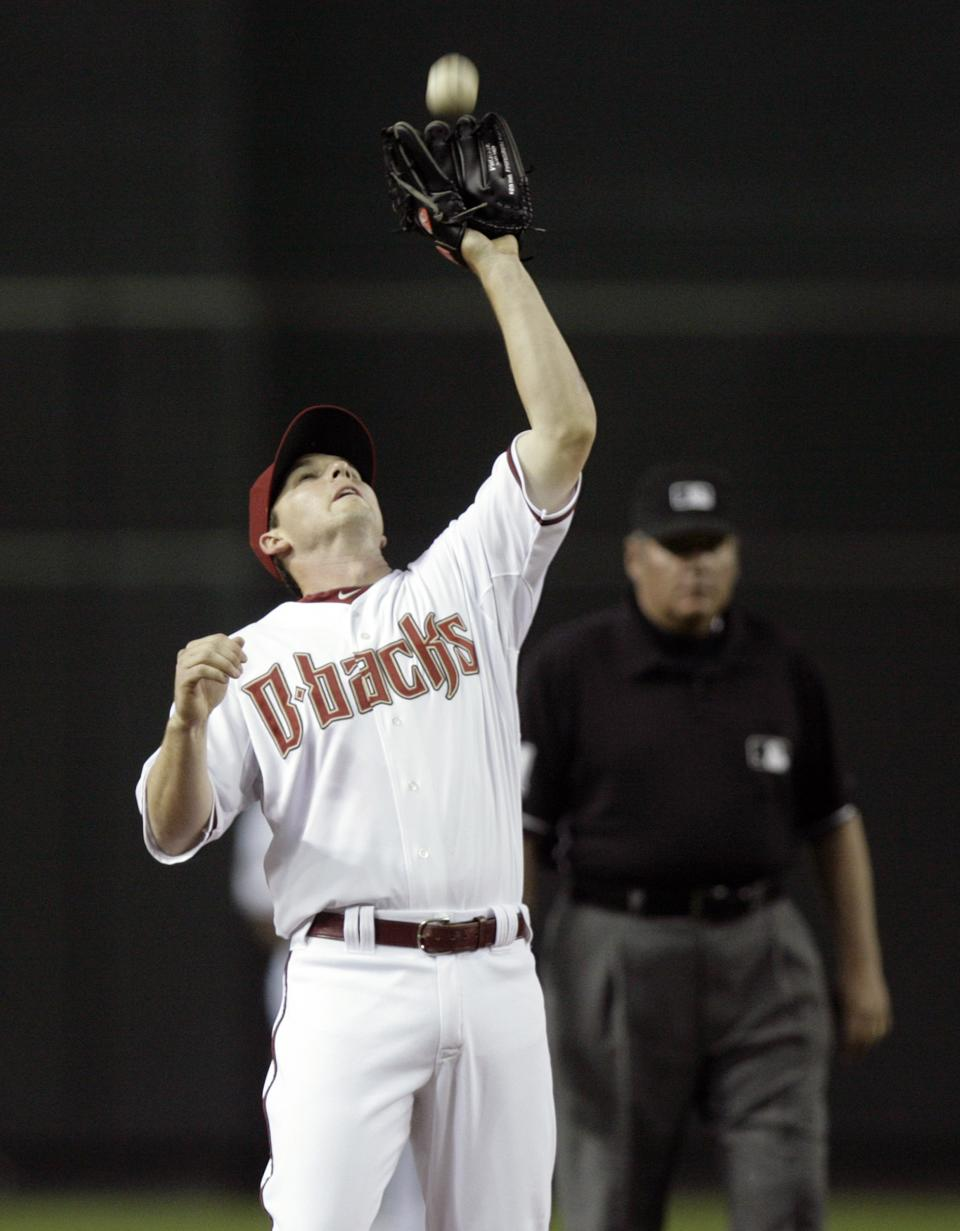 Arizona Diamondbacks shortstop Stephen Drew catches a popup hit by St. Louis Cardinals' Albert Pujols for an out in the third inning of a baseball game Monday, April 11, 2011, in Phoenix. (AP Photo/Paul Connors)