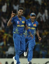 Sri Lankan cricketer Angelo Mathews (L) celebrates with teammate Ajantha Mendis after he dismissed Pakistan batsman Kamran Akmal during their ICC Twenty20 Cricket World Cup's semi-final match at the R. Premadasa International Cricket Stadium in Colombo. Sri Lanka won by 16 runs