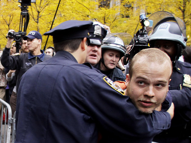 Police arrest an Occupy Wall Street protester at Zuccotti Park on Tuesday, Nov. 15, 2011 in New York. After an early police raid removing protesters, hundreds returned to Zuccotti Park carrying photocopies of a court order they say gives them the right to return there. The National Lawyers Guild obtained a court order allowing the protesters to return with their tents to the park, where they have camped for two months. The guild said the injunction prevents the city from enforcing park rules on the protesters. (AP Photo/Bebeto Matthews)
