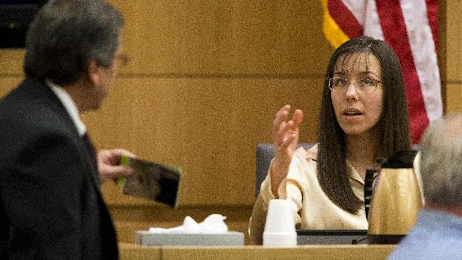 Prosecutor Juan Martinez, left, cross examines Jodi Arias a during her trial in Maricopa County Superior Court, Tuesday, Feb. 26, 2013. Arias is on trial for the murder of her boyfriend, Travis Alexander, in 2008. (AP Photo/The Arizona Republic, Tom Tingle)  MARICOPA COUNTY OUT; MAGS OUT; NO SALES