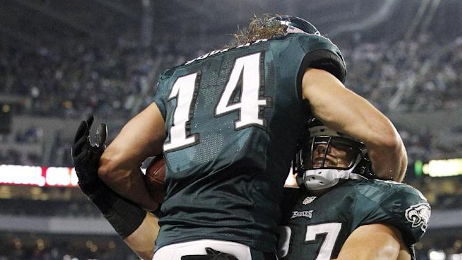 Philadelphia Eagles wide receiver Riley Cooper (14) celebrates with Brent Celek (87) and Stanley Havili (39) after scoring a touchdown against the Dallas Cowboys during the second half of an NFL football game, Sunday, Dec. 2, 2012, in Arlington, Texas. (AP Photo/Tony Gutierrez)