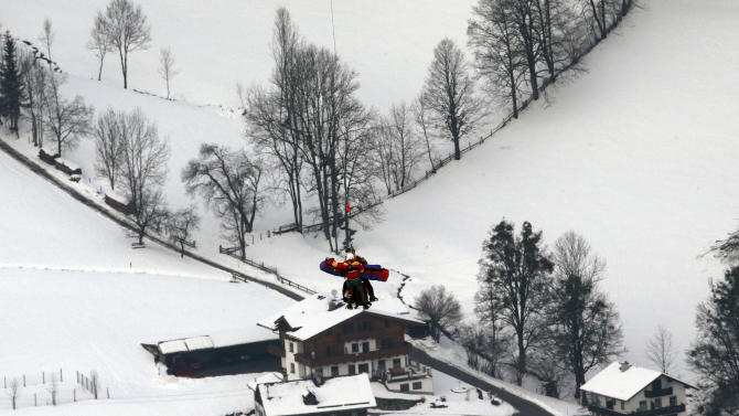 United States' Lindsey Vonn is airlifted after crashing during the women's super-G course, at the Alpine skiing world championships in Schladming, Austria, Tuesday, Feb.5, 2013. Vonn crashed during the super-G and has been taken by helicopter to a hospital from the world championships after apparently injuring her right knee. The American lost balance on her right leg while landing after a jump. Her ski came off immediately, and Vonn slid off course and hit a gate before coming to a standstill. Vonn received medical treatment on the slope for 12 minutes before going to the hospital. (AP Photo/Luca Bruno)