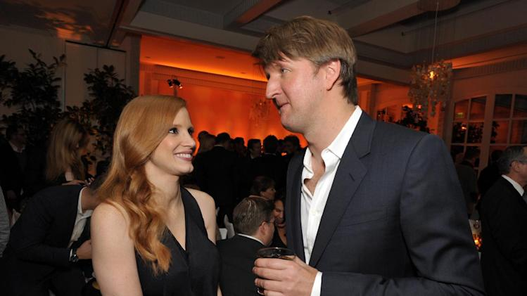 Jessica Chastain, left, and Tom Hooper attend The Hollywood Reporter Nominees' Night at Spago on Monday, Feb. 4, 2013, in Beverly Hills, Calif. (Photo by John Shearer/Invision for The Hollywood Reporter/AP Images)