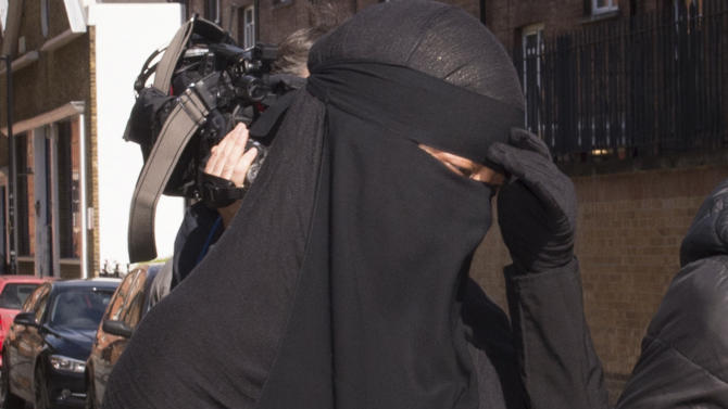 In this photo from Monday Sept 16 2013, a Muslim woman, who cannot be named for legal reasons, arrives at Blackfriars Crown Court in London where a judge has ruled that she will be allowed to stand trial while wearing a full-face veil but must remove it while giving evidence. The case has reignited a debate about Muslim veils that has flared across Europe, sparking protests and exacerbating religious tensions in several countries. (AP Photo/ Stefan Rousseau/PA) UNITED KINGDOM OUT NO SALES NO ARCHIVE