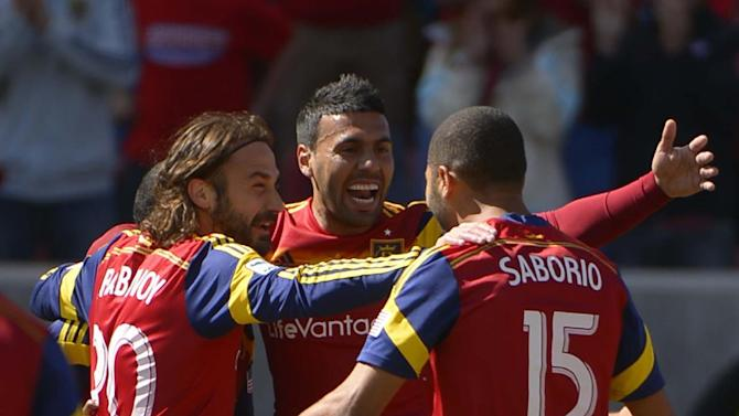 Real Salt Lake midfielders Ned Grabavoy (20) and Javier Morales (11) celebrate forward Alvaro Saborio's  (15) first-half goal against L.A. Galaxy during their MLS soccer game, Saturday, March 22, 2014, in Salt Lake City