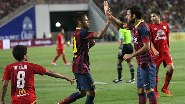 Barcelona's Neymar (2nd L) celebrates with teammate Cesc Fabregas after scoring against Thailand's national team during their friendly match at Rajamangala national stadium in Bangkok August 7, 2013 (Reuters)