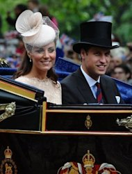 Catherine, Duchess of Cambridge, and Prince William during a carriage procession celebrating the queen&#39;s Diamond Jubilee in June. Their first engagement will be an orchid naming ceremony in Singapore when flowers will be named after them