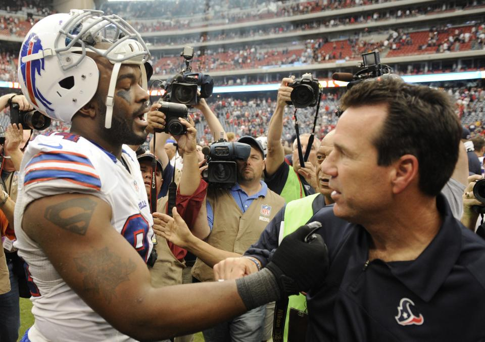Buffalo Bills defensive end and former Houston Texan Mario Williams speaks with Texans coach Gary Kubiak in the fourth quarter of an NFL football game on Sunday, Nov. 4, 2012, in Houston. (AP Photo/Dave Einsel)