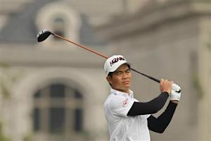 Liang of China plays a shot on the first hole during the BMW Masters 2012 golf tournament at Lake Malaren Golf Club in Shanghai