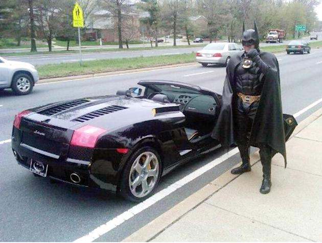 Holy cow Batman! Children's entertainer Lenny Robinson was pulled over by police because he didn't have a proper number plate for his Batmobile - a swish black Lamborghini Gallado. Instead of a licenc