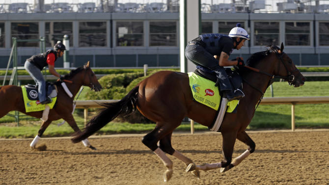 Exercise rider Javier Harrera rides Kentucky Derby hopeful Normandy Invasion, right, in front Goldencents during a workout at Churchill Downs Wednesday, May 1, 2013, in Louisville, Ky. (AP Photo/Morry Gash)