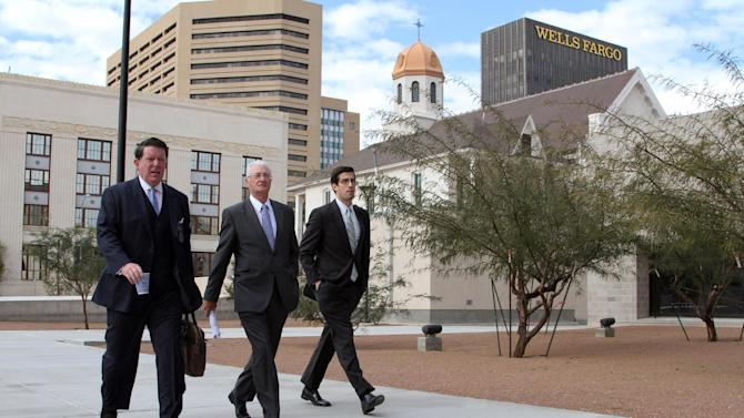 ADDS SENTENCING DETAILS - British Businessman Christopher Tappin, center, his attorney Dan Cogdell, left, and an unidentified man arrive at federal court in El Paso, Texas, Wednesday, Jan. 9, 2013. U.S. District Judge David Briones sentenced Tappin Wednesday to two years and nine months in prison, and said he would recommend that the Department of Justice approve any request by Tappin to be transferred to the United Kingdom. Tappin pleaded guilty in November to trying to buy missile parts and resell them to Iran. (AP Photo/Juan Carlos Llorca)