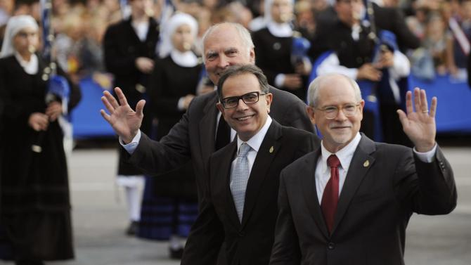 Scientists Galen D. Stucky, Avelino Corma and Mark E. Davis wave before receiving the Prince of Asturias award for Technical and Scientific Research in Oviedo