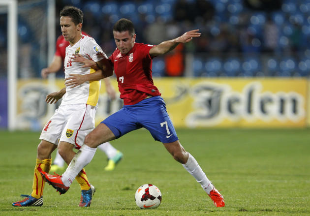 Serbia's Zoran Tosic, right challenges for the ball with Macedonia's Predrag Randelovic during their World Cup 2014 Group A qualifying soccer match at the City Stadium in Jagodina, Serbia, Tuesday, Oc