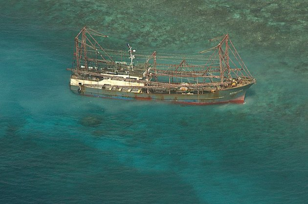 A Chinese fishing boat sits on the Tubbataha reef, in Palawan island, western Philippines, April 10, 2013. The Philippine coast guard said Monday it had found hundreds of frozen scaly anteaters, or pangolins, in the cargo hold of a Chinese boat that ran aground in a protected marine sanctuary last week
