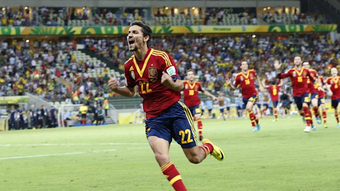 Spain's Jesus Navas celebrates after scoring his side winning penalty against Italy during the soccer Confederations Cup semifinal match between Spain and Italy at Castelao stadium in Fortaleza, Brazil, Thursday, June 27, 2013. Spain won 7-6 in a penalty shoot-out. (AP Photo/Eugene Hoshiko)