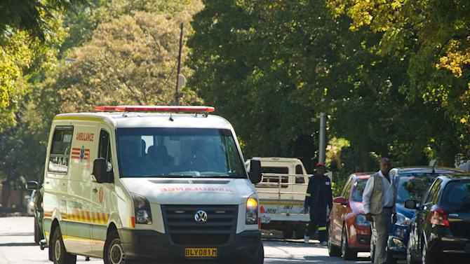 """An ambulance believed to be transporting former president Nelson Mandela arrives at the home of Mandela in Johannesburg, Saturday, April 6, 2013. The South African Presidency has confirmed that  Mandela has been discharged after spending nine days in hospital in Pretoria. Spokesman Mac Maharaj says the elder statesman was discharged, """"following a sustained and gradual improvement in his general condition,"""" and thanked all South Africans and people around the world for their support. He says Mandela will now receive home based high care. Mandela was admitted to hospital on March 27 with pneumonia. Since then the 94-year-old former statesman has had fluid drained from his lungs to ease his breathing. (AP Photo)"""