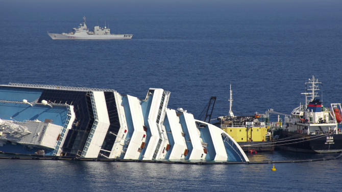 Ongoing operations to remove fuel from the half sunken hulk of the luxury ship Costa Concordia a month after it ran aground are seen outside the port of Isola del Giglio island in Tuscany, Italy, Monday, Feb. 13, 2012. (AP Photo/Giorgio Fanciulli)