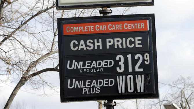 The cash price for unleaded fuel along with an editorial comment on unleaded-plus fuel was posted on a sign at a Minneapolis care care center Tuesday, Nov. 26, 2013, in Minneapolis, as gas prices continue to fall just in time for Thanksgiving and holiday spending. The average price of gasoline has tumbled 49 cents from their peak this year to $3.29 a gallon, putting shoppers on track to have the lowest prices at the pump since 2010, according to AAA. (AP Photo/Jim Mone)