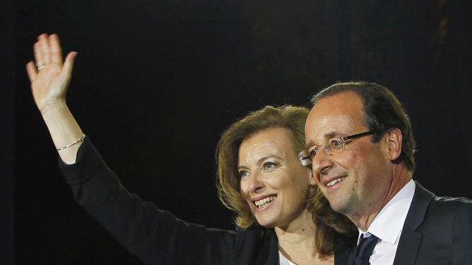 FILE - This Sunday May 6, 2012 file photo shows French president-elect Francois Hollande and his companion Valerie Trierweiler celebrating his election victory in Bastille Square in Paris, France. A French news agency has reported that President Francois Hollande has ended his relationship with his companion of seven years Valerie Trierweiler. (AP Photo/Francois Mori, File)