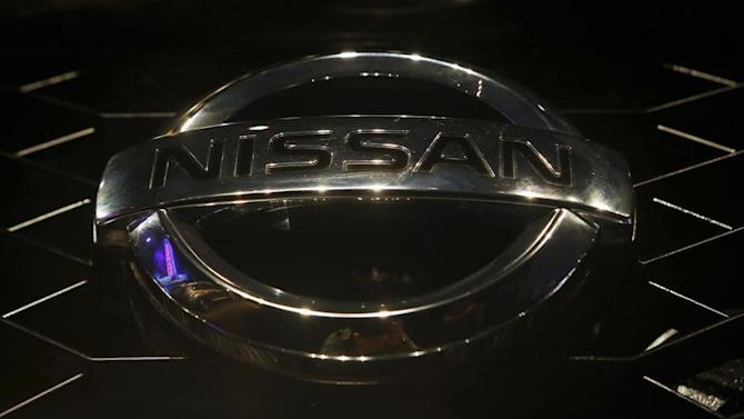 """A company logo is seen on the newly-unveiled Nissan """"Terrano"""" compact sport utility vehicle during a news conference in Mumbai"""