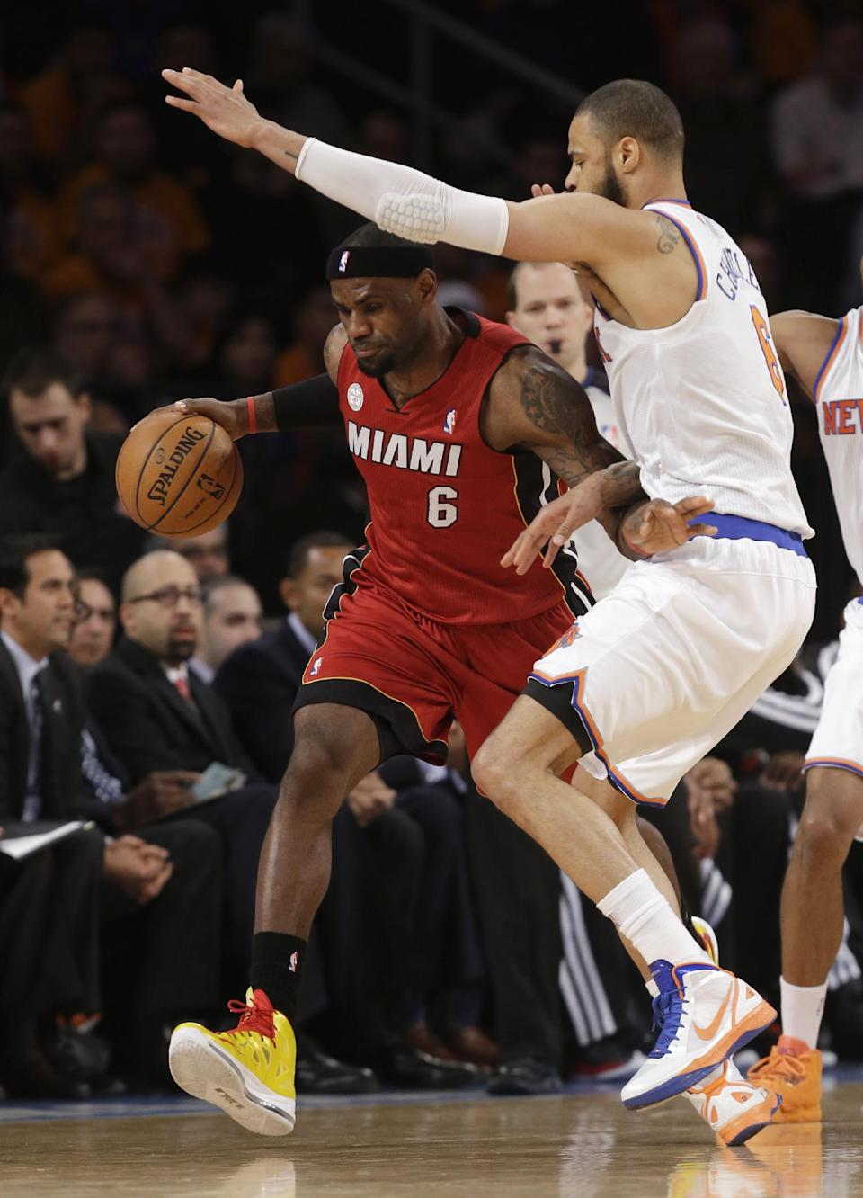Miami Heat forward LeBron James (6) drives against New York Knicks center Tyson Chandler (6) during the first half of their NBA basketball game at Madison Square Garden in New York, Sunday, March 3, 2013. (AP Photo/Kathy Willens)