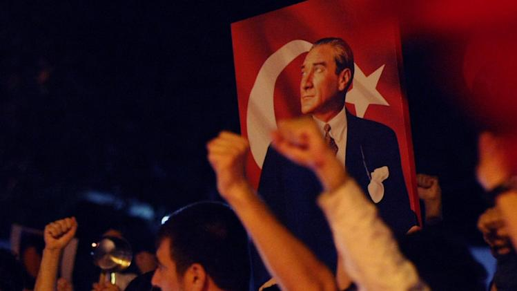"Thousands of Turkish protesters, holding national flags and portraits of Turkey's founder Mustafa Kemal Ataturk, jubilate as they march in Turkish capital, Ankara, Thursday, June 6, 2013.  Turkish Prime Minister Recep Tayyip Erdogan on Thursday appeared to have slightly moderated his rhetoric regarding the anti-government protests in his country but didn't back away from redevelopment plans for Istanbul that sparked the nearly week-long unrest and claimed ""terrorist groups"" were involved in the unrest.    (AP Photo/Burhan Ozbilici)"