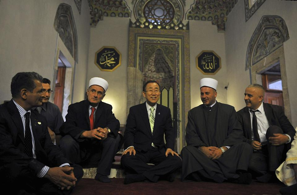 Secretary-General of the United Nations Ban Ki-moon , center, joined by Imams visits the Sinan Pasha mosque in the western town of Prizren on Tuesday, July 24, 2012. The Secretary-General is on a regional tour of southeastern Europe. ( AP Photo/Visar Kryeziu)