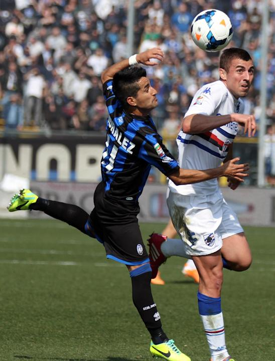 Atalanta's Maximiliano Moralez, left, of Argentina, challenges Sampdoria's Nenad Krsticic, of Serbia, during a Serie A soccer match in Bergamo, Italy, Sunday, March 16, 2014