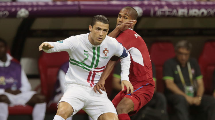 Portugal's Cristiano Ronaldo and Czech Republic's Theodor Gebre Selassie vie for the ball during the Euro 2012 soccer championship quarterfinal match between Czech Republic and Portugal in Warsaw, Poland, Thursday, June 21, 2012. (AP Photo/Ivan Sekretarev)