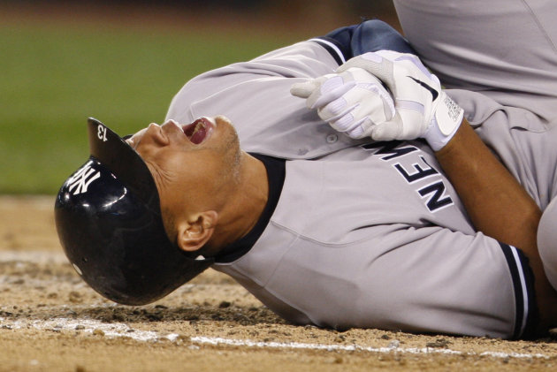 New York Yankees' Alex Rodriguez rolls on the ground after being hit by a pitch in the eighth inning of a baseball game against the Seattle Mariners, Tuesday, July 24, 2012, in Seattle. Even as Rodrig