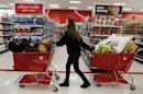 "A woman pulls shopping carts through the aisle of a Target store on the shopping day dubbed ""Black Friday"" in Torrington"